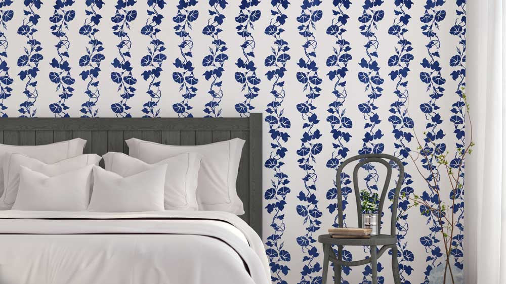stenciled floral accent wall bedroom
