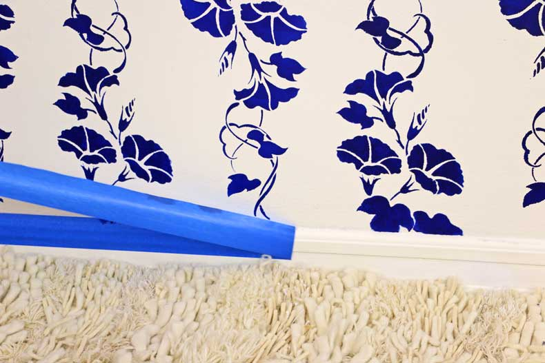 stencil floral feature wall remove tape baseboard