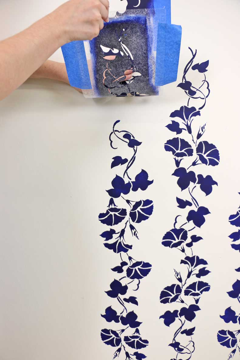 stencil floral feature wall align top