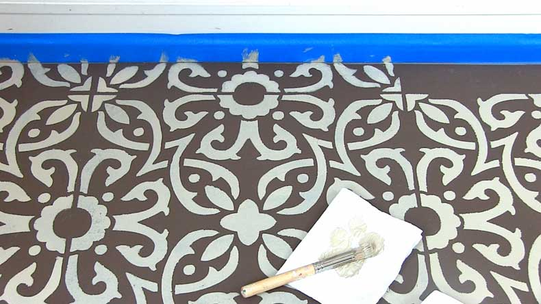stenciled floor near baseboard