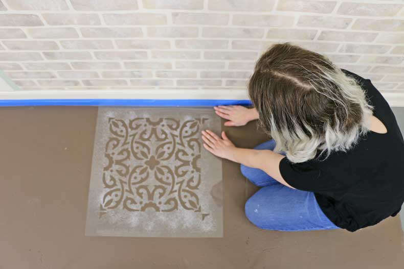 placing tile stencil on floor