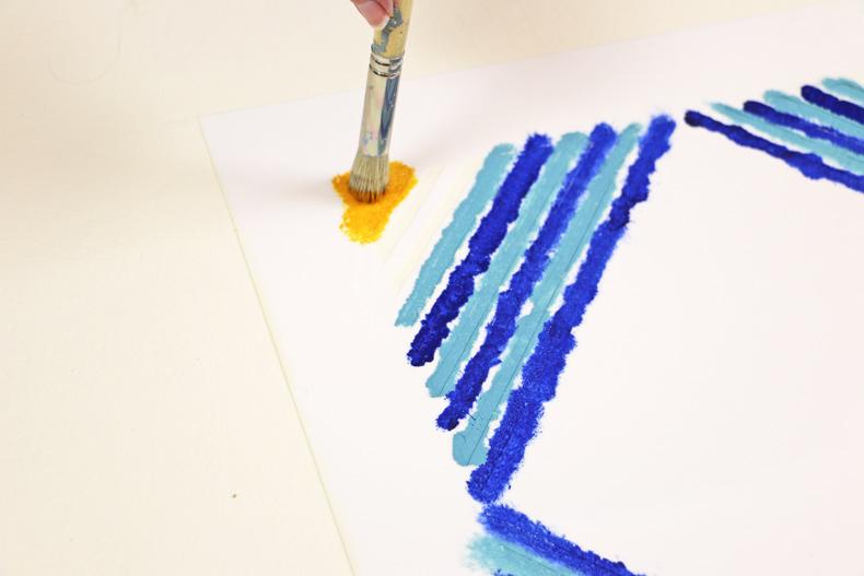 Painting tile stencil pattern on floor