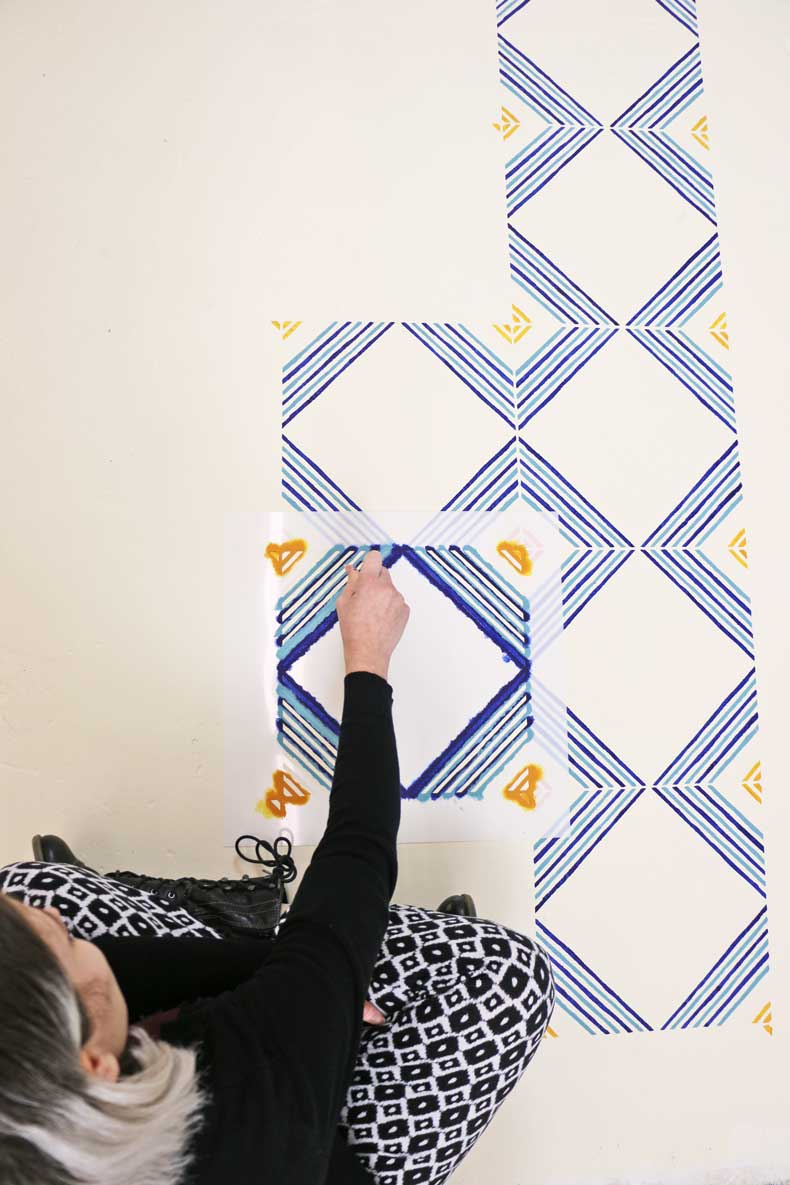 Painting tile stencil pattern on floor