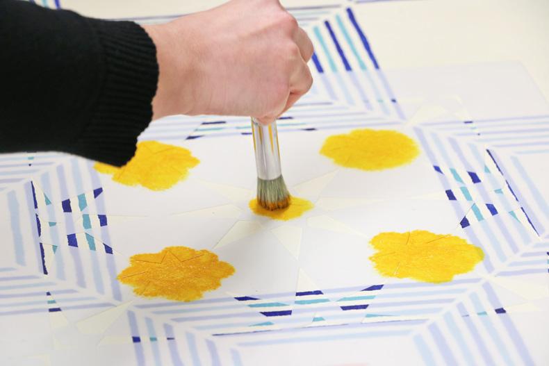 Tile stencil pattern painted on floor