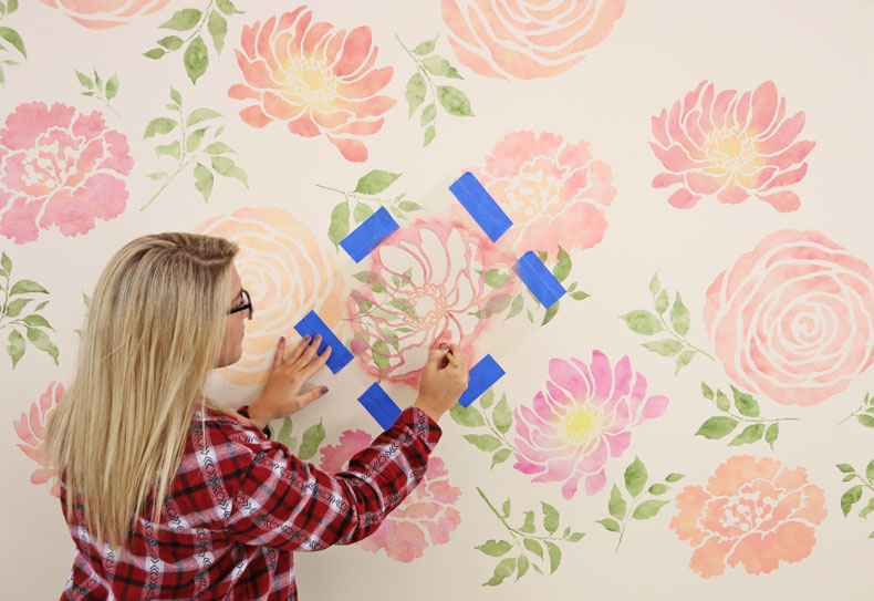 Painting over the floral wall stencil pattern