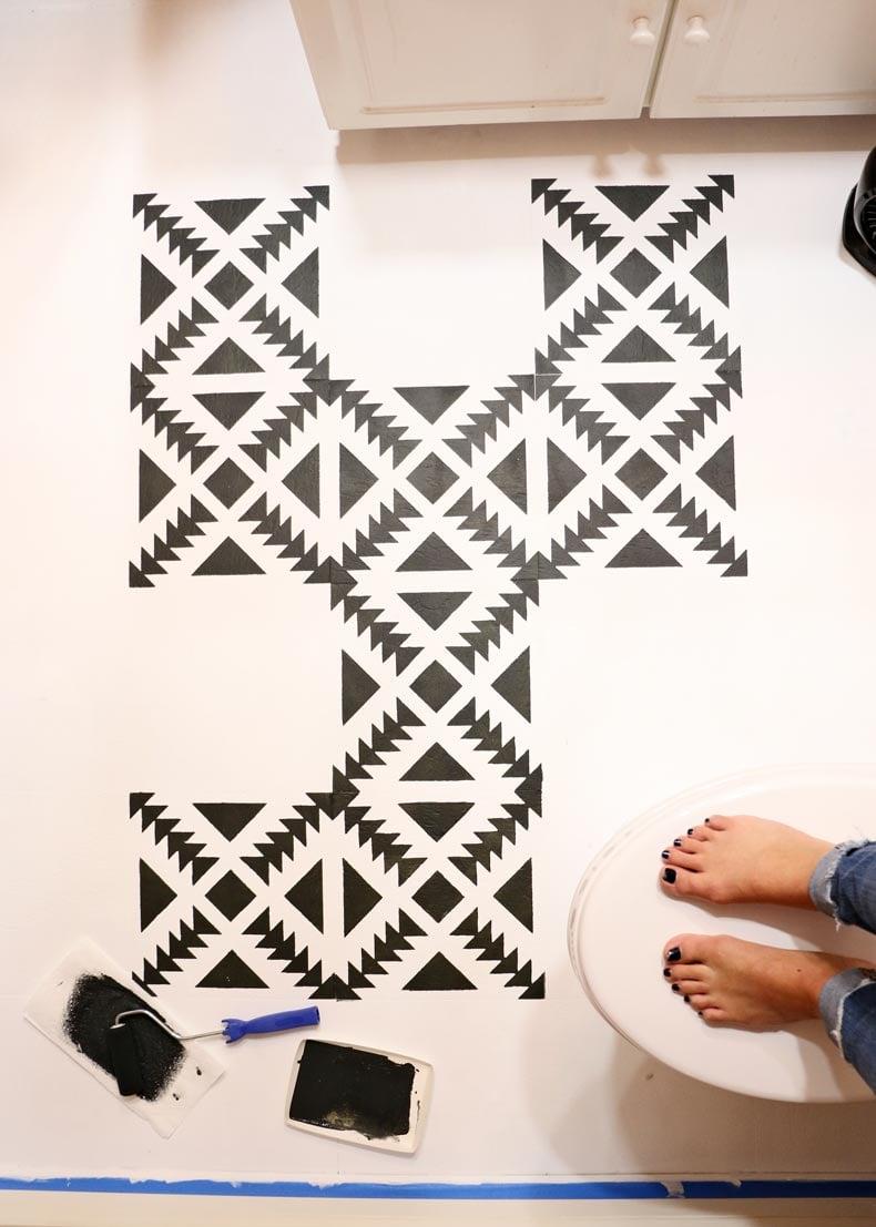 Partially complete stenciled bathroom floor