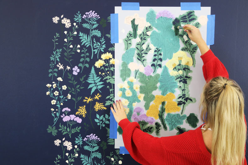 Painted and stenciled floral design for feature wall