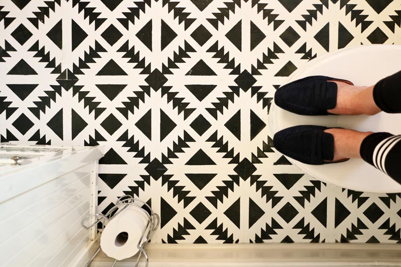 Painted and stenciled bathroom tile floor
