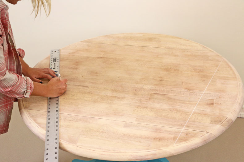 Measuring table top to find the center