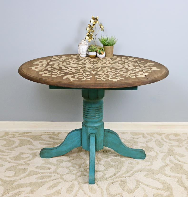 Final photo of upcycled wooden table with mandala stencil