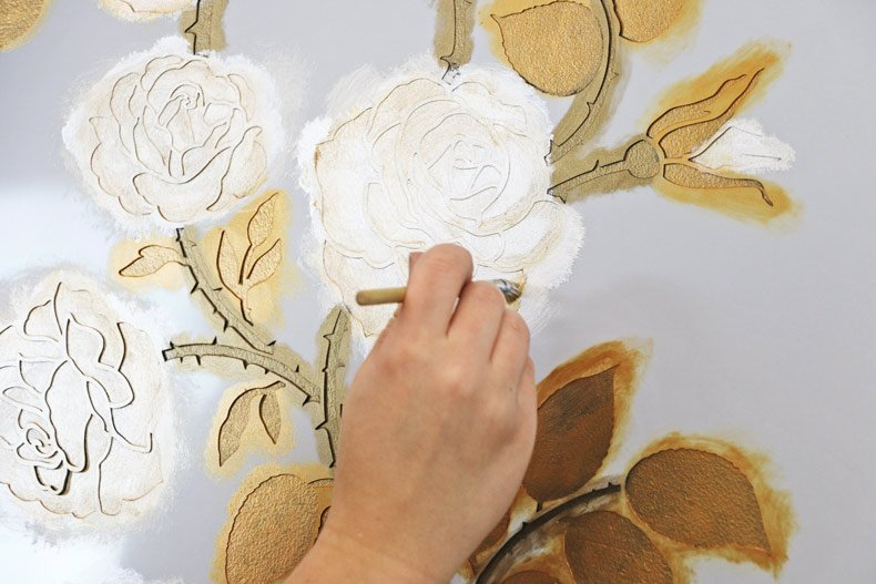 Shading the flowers in with gold