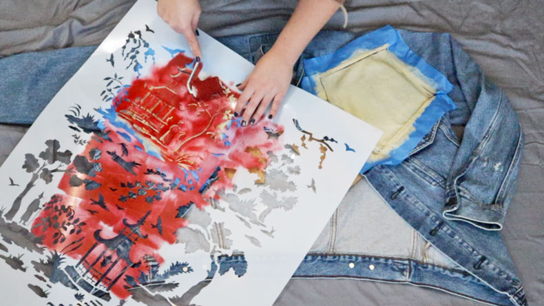 stenciling a denim jacket with a toile design