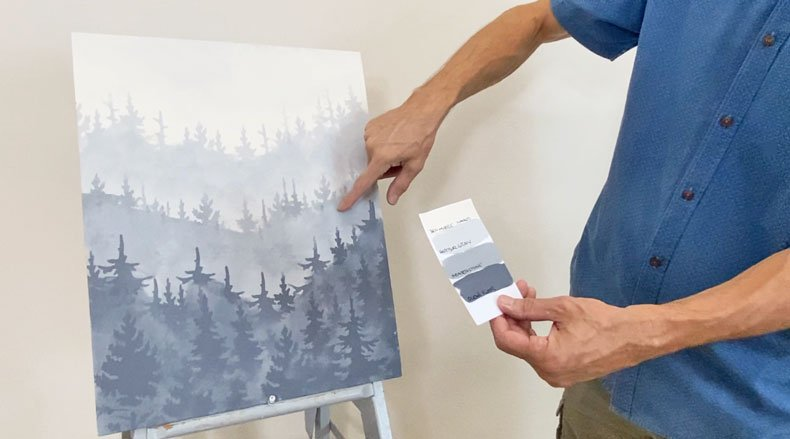 man holding paint color swatch