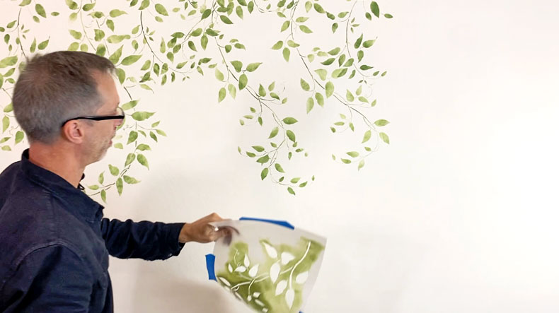 vine wall stencil kit on white accent wall