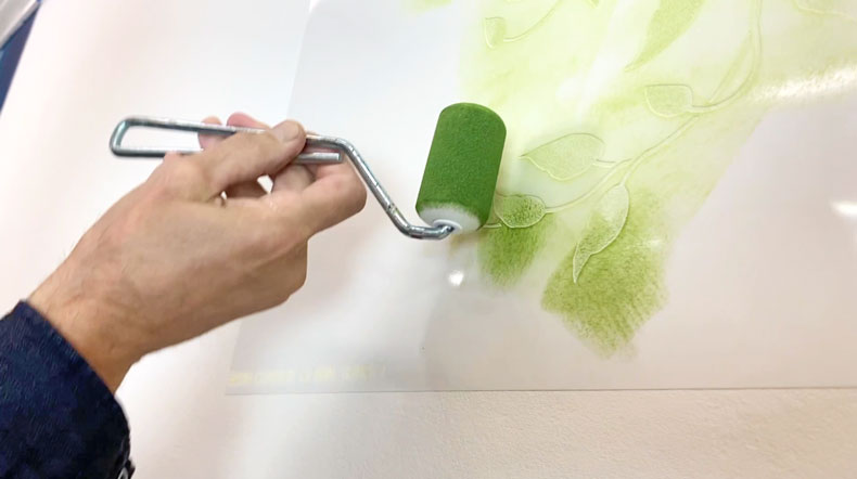 roller for stenciling over vine wall stencil