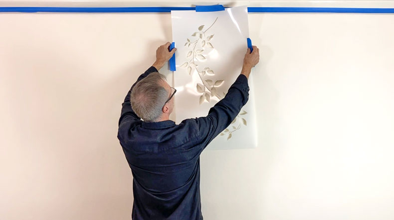 man hanging vine wall stencil
